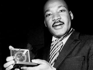 Martin Luther King Jr. holding the Nobel Peace Prize he won in 1964.Youtube