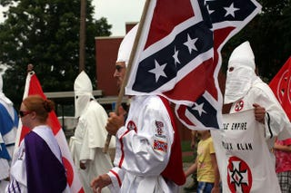 Members of the Fraternal White Knights of the Ku Klux Klan participate in the 11th annual Nathan Bedford Forrest Birthday march July 11, 2009, in Pulaski, Tenn. Spencer Platt/Getty Images