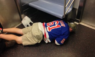 Illustration for article titled Fallen Rangers Fan Is The Saddest Subway Rider