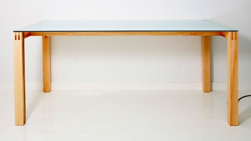 Illustration for article titled Where Is This Beautiful Table Hiding an AirPlay Speaker?