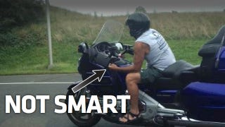 Illustration for article titled Is This Man Texting While Riding A Motorcycle?
