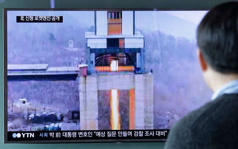 A man watches a TV news program from South Korea showing an image of a  high-thrust rocket engine in North Korea on March 19, 2017  (AP Photo/Ahn Young-joon)
