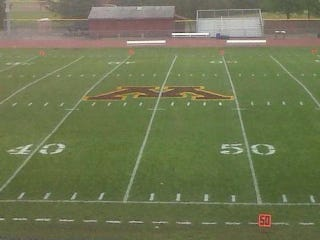 Illustration for article titled Some College In Minnesota Painted Its Midfield Logo On The Wrong Yard Line