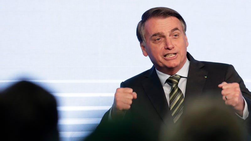 Brazilian President Jair Bolsonaro speaking to a steel industry meeting, where he falsely claimed NGOs are burning down the Amazon in retaliation for budget cuts, on Wednesday.