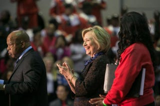 Democratic presidential candidate Hillary Clinton (center) takes the stage with Rep. John Lewis during an African Americans for Hillary rally at Clark Atlanta University on Oct. 30, 2015.  Jessica McGowan/Getty Images