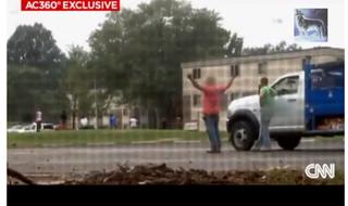 Contractors who witnessed Michael Brown's shooting reacting on the sceneCNN screenshot