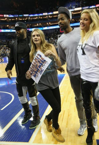Model Cara Delevingne and singer Ellie Goulding attend the Eastern Conference NBA match between the Brooklyn Nets and Atlanta Hawks at London's O2 Arena Jan. 16, 2014.Julian Finney/Getty Images
