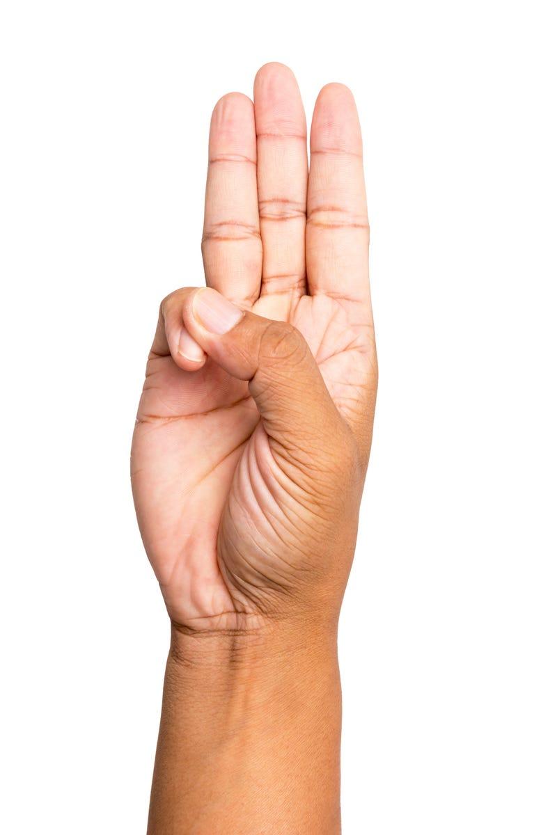 Scout honor hand gestureiStock