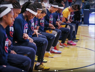 The entire Indiana Fever team kneels during the national anthem prior to their Sept. 21, 2016, game against the Phoenix Mercury.@MarissaC_25 via Twitter