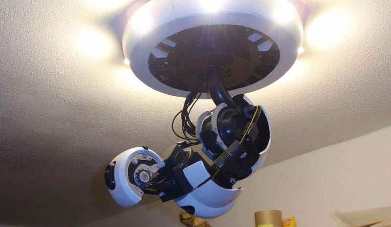 Illustration for article titled Brave Man Invites GlaDOS Into His Home And Onto His Ceiling