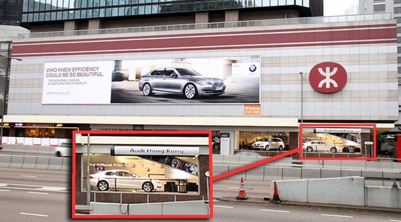 Illustration for article titled BMW Slaps Audi Dealership With Giant Billboard