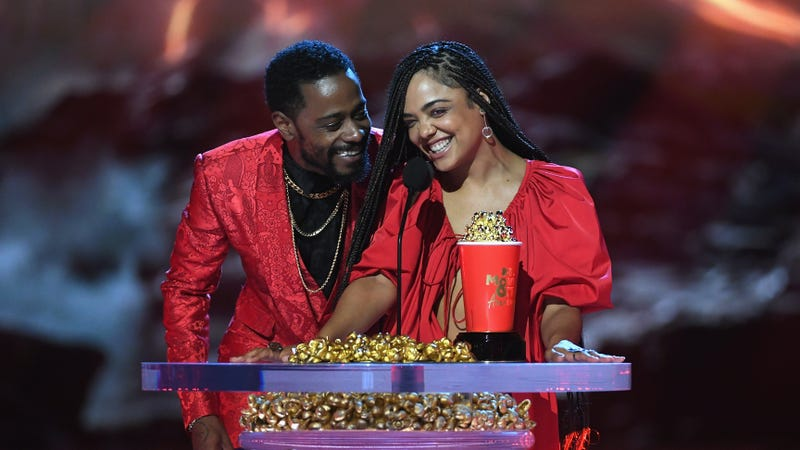 Lakeith Stanfield, left, and Tessa Thompson speak onstage during the 2018 MTV Movie And TV Awards on June 16, 2018 in Santa Monica, CA.