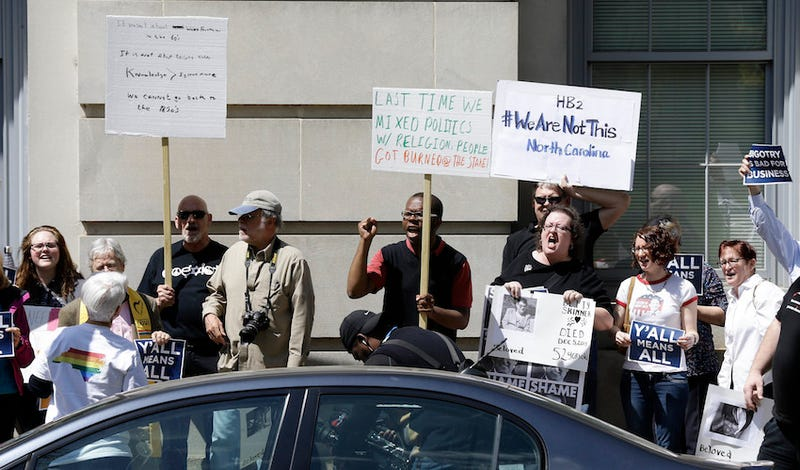 Opponents of House Bill 2 protest across the street from the State Capitol Building in Raleigh, N.C., Monday, April 11, 201. (Photo: AP)