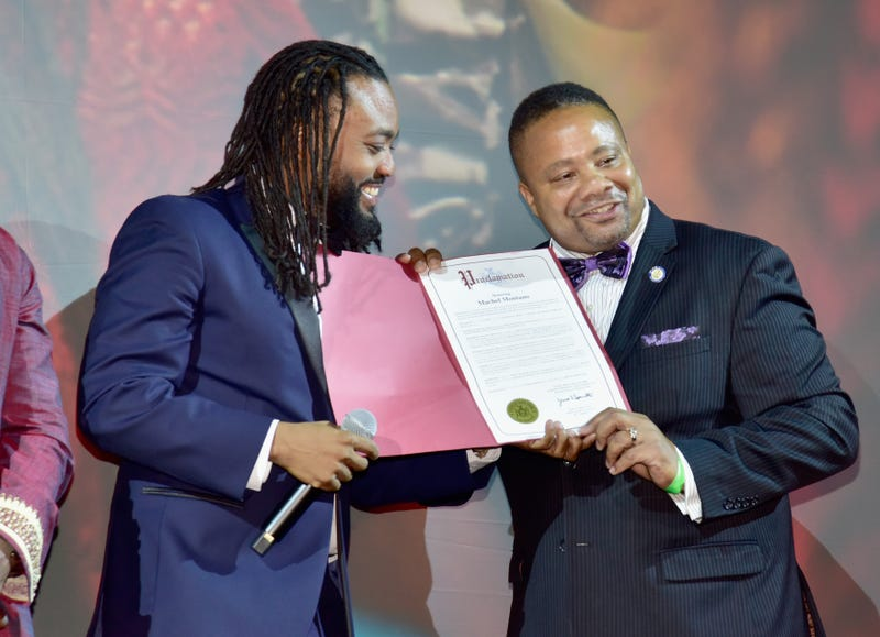 Actor Machel Montano and New York State Senator Jesse Hamilton speak onstage during Bazodee premiere and concert featuring Machel Montano and friends at PlayStation Theater on July 27, 2016 in New York City.