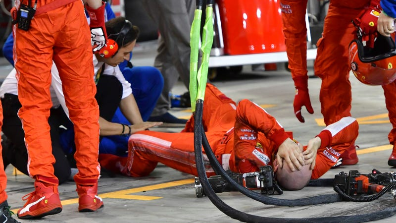 Illustration for article titled Ferrari Pit Mechanic's Leg Gets Bent In Several Wrong Directions By Accelerating Car