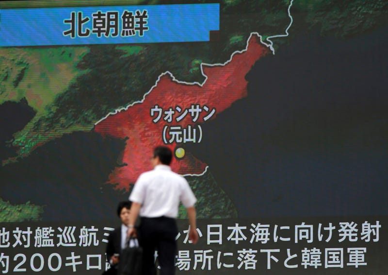 A screen shows a news program reporting about North Korea's missile firing from Wonsan, center, Thursday, June 8, 2017, in Tokyo. North Korea fired several suspected short-range anti-ship missiles off its east coast Thursday, South Korea's military said, in a continuation of defiant launches as it seeks to build a nuclear missile capable of reaching the continental United States. (AP Photo/Eugene Hoshiko)