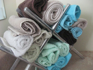 Repurpose A Wine Rack As A Towel Holder