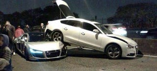 Illustration for article titled Audi R8 Locked In Embrace With A5 Sportback In Bizarre Crash