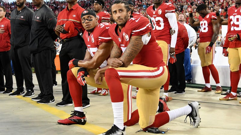 Colin Kaepernick, foreground (Thearon W. Henderson/Getty Images)