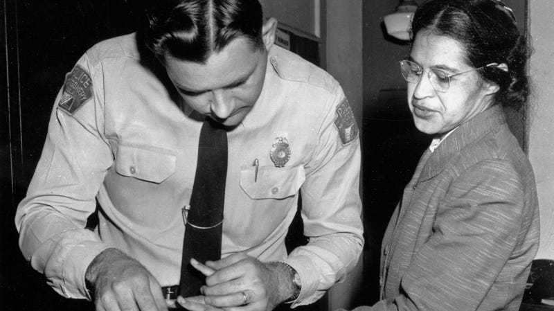 Rosa Parks is fingerprinted by police Lt. D.H. Lackey in Montgomery, Ala., after refusing to give up her seat on a bus for a white passenger on Dec. 1, 1955