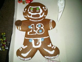 Illustration for article titled Gingerbread Peyton Manning Has Reese's Cup Football, Frosting Dong