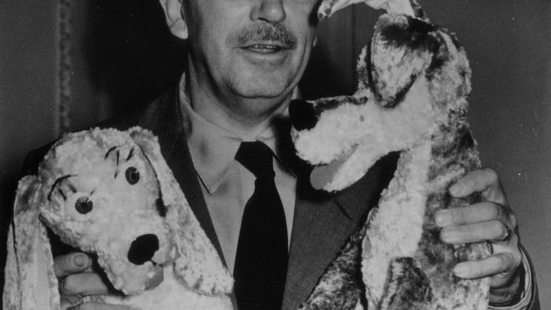 Walt Disney making dogs kiss in 1949