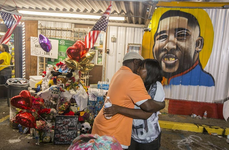 Sandra Sterling (right), Alton Sterling's aunt, visits his memorial on July 7, 2016, in Baton Rouge, La. (Mark Wallheiser/Getty Images)