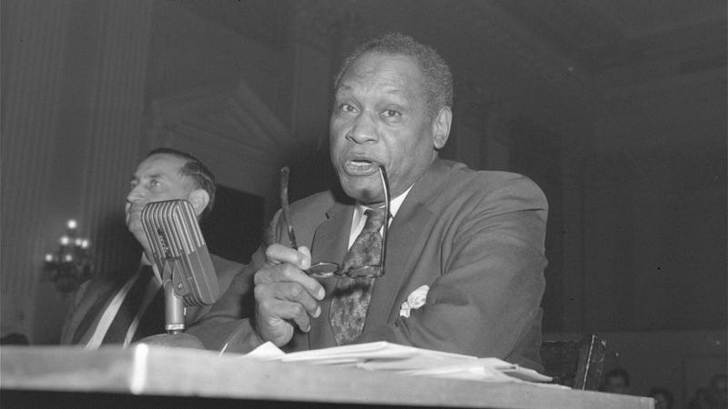 "Singer Paul Robeson testifies in Washington, D.C., on June 12, 1956, before the House Committee on Un-American Activities. After a furious shouting session between the singer and Chairman Walter (D-Pa.) and other committee members, the group voted to cite Robeson for contempt. Later, Robeson told a reporter, ""There was no contempt—I was just standing my ground."" (Bill Achatz/AP Images)"