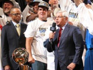 David Stern (right) presents 2011 NBA trophy to Mark Cuban.(Mike Ehrmann/Getty Images)