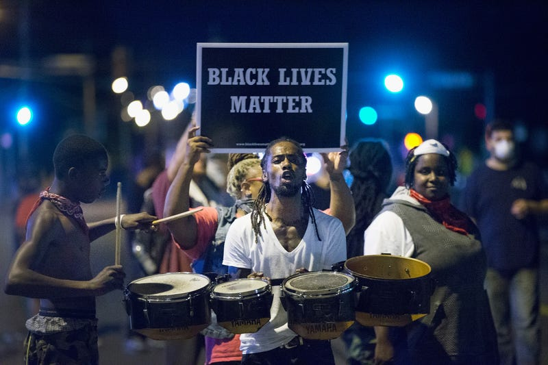 Demonstrators, marking the one-year anniversary of the shooting of Michael Brown in Ferguson, Mo., protest along West Florissant Street in Ferguson on Aug. 10, 2015.Scott Olson/Getty Images
