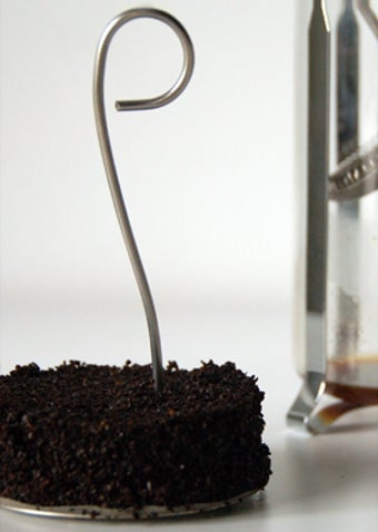 Illustration for article titled Coffee Catcher Filters and Simplifies Your French Press