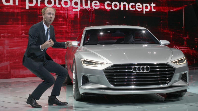 Illustration for article titled Caption This Hilarious Photo Of An Audi Presenter At The LA Auto Show