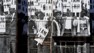 A building in Washington, D.C., is decorated with a giant print of the 1968 iconic photo of a sanitation strike in Memphis, Tenn., by Ernest Withers.MLADEN ANTONOV/AFP/GettyImages