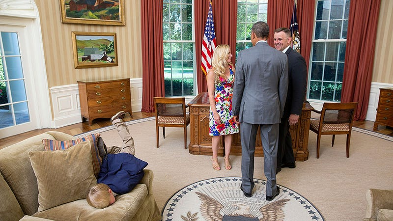 Illustration for article titled This Kid Is So Done With Obama He Can't Even Keep Himself Upright