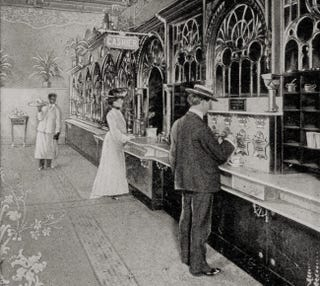 Postcard picture of an Automat in Philadelphia, circa 1904 (Wikimedia Commons)