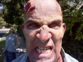 Illustration for article titled Photo of Anthrax Guitarist Scott Ian as Zombie in The Walking Dead