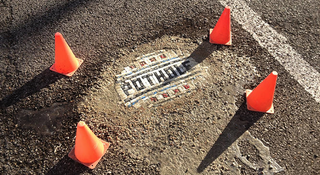 Illustration for article titled There's a Hero Repairing Chicago's Horrible Potholes With Mosaics