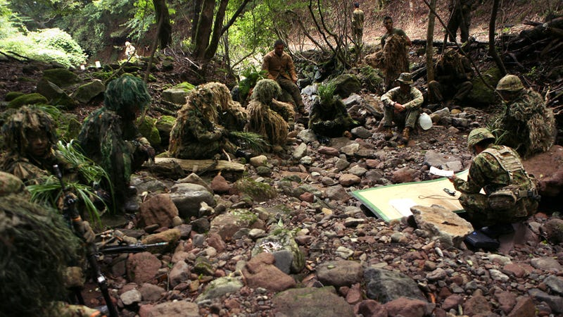 Illustration for article titled How Many Marine Snipers Can You Count In This Photo?
