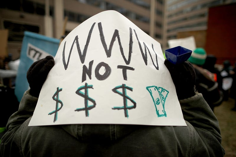 Demonstrators rally outside the Federal Communications Commission building to protest the end of net neutrality rules Dec. 14, 2017, in Washington, D.C.
