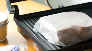 Illustration for article titled Wrap Sandwiches in Parchment Paper Before Pressing for Easy, Hassle-Free Cleanup