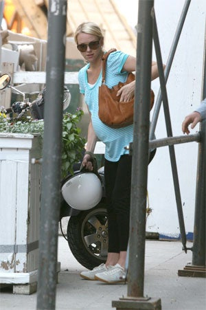 Illustration for article titled At Least Extremely-Pregnant Naomi Watts Accessorized Her Vespa With A Helmet