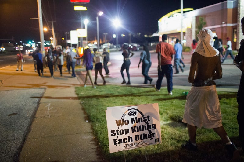 Demonstrators gather on West Florissant Avenue in Ferguson, Mo., in 2015 to mark the one-year anniversary of the shooting death of Michael Brown. Reports indicate a demonstration Aug. 9, 2016, to mark the second anniversary of the unarmed teen's death was marred by gunfire and a protester being hit by a car. Scott Olson/Getty Images