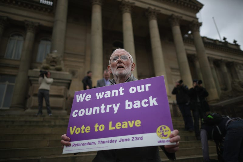 "A ""Vote to leave"" campaigner holds a placard on May 25, 2016, in Bolton, England.Christopher Furlong/Getty Images"