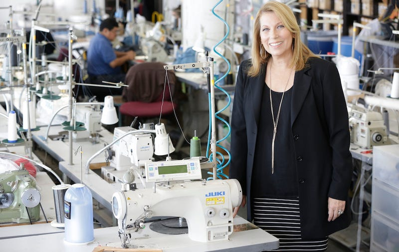American Apparel CEO Paula Schneider poses in the company's Los Angeles factory in June 2015. (Image via Getty)