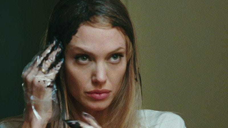 Angelina Jolie prepares herself for… uh, action, I guess?