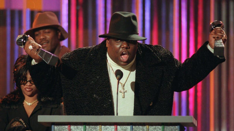 Notorious B.I.G., who won rap artist and rap single of the year, clutches his awards at the podium during the Billboard Music Awards in New York, on evening, Dec. 6, 1995.