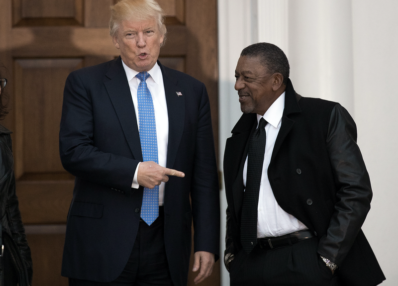 Then-President-elect Donald Trump greets Robert Johnson, the founder of Black Entertainment Television, at Trump International Golf Club on Nov. 20, 2016, in Bedminster Township, N.J.