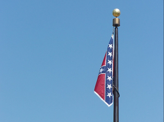 Illustration for article titled 1 Confederate Flag Removed at Alabama State Capitol, Only 3 More to Go