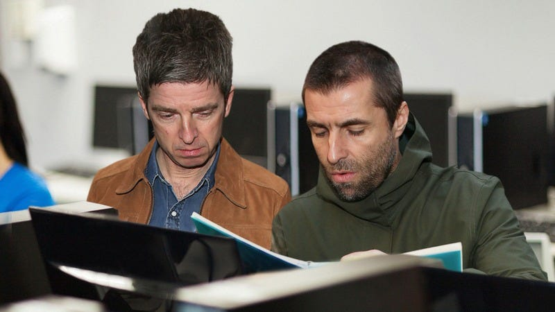 Noel and Liam Gallagher reading together.