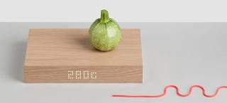 Illustration for article titled A Gorgeous Wooden Kitchen Scale That Masquerades as a Cutting Board